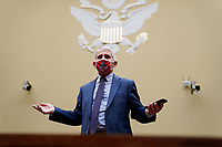 """Anthony Fauci, director of the National Institute of Allergy and Infectious Diseases, wears a Washington Nationals protective mask while arriving to a House Select Subcommittee on the Coronavirus Crisis hearing in Washington, D.C., U.S., on Friday, July 31, 2020. The hearing is titled """"The Urgent Need for a National Plan to Contain the Coronavirus."""" <br /> Credit: Erin Scott / Pool via CNP /MediaPunch"""