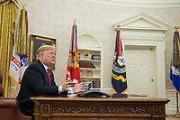 United States President Donald J. Trump answers questions from members of the press following a video call to service members from the Army, Marine Corps, Navy, Air Force, and Coast guard stationed worldwide in the Oval Office at the White House in Washington, D.C.,  U.S., on December 25, 2018. Photo Credit: Zach Gibson/CNP/AdMedia