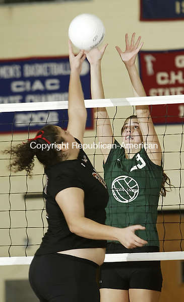 BERLIN, CT, 11/17/07- 111707BZ08- Cheshire's Nora Bahgat (27) goes up against New Milford's Emma Crowcroft (23) during the class LL final at Berlin High School Saturday night.<br /> Jamison C. Bazinet Republican-American