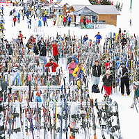 Downhill Skis and Snowboards leaning against Racks at the Roundhouse Lodge on Whistler Mountain, Whistler Ski Resort, BC, British Columbia, Canada