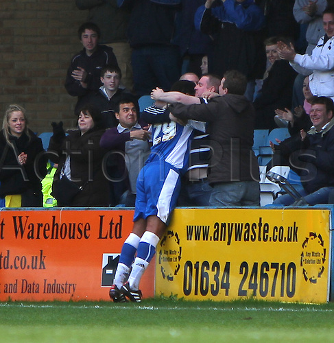 05/04/2010. Gillingham fans in the crowd embrace Rene Howe after Howe had scored his side's second goal. Division 1 match - Gillingham v Southend United at Gillingham, Kent, England, UK