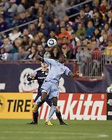 New England Revolution defender Seth Sinovic (27) and Colorado Rapids forward Omar Cummings (14) battle for head ball. The Colorado Rapids defeated the New England Revolution, 2-1, at Gillette Stadium on April 24, 2010.