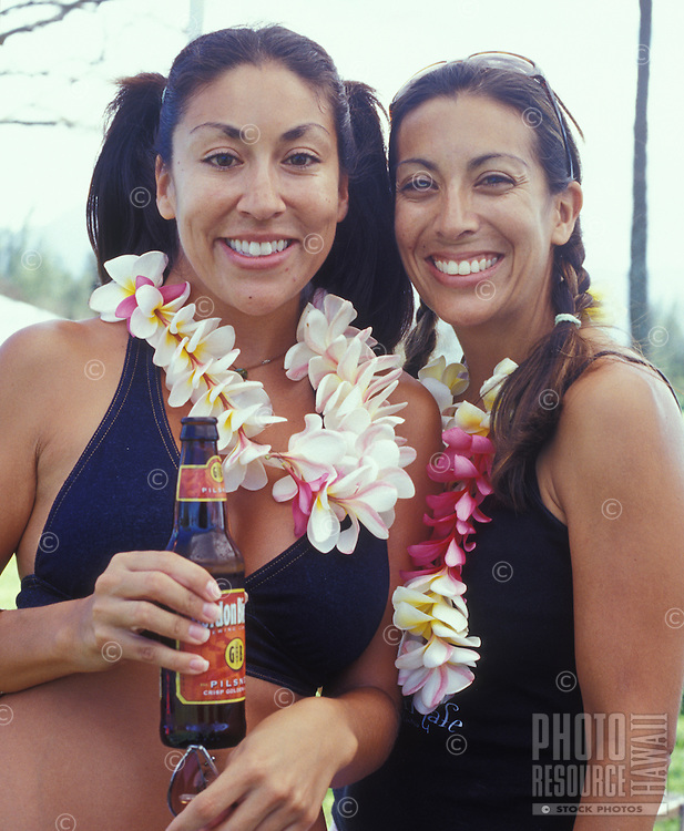 Portrait of two local women with plumeria leis and a beer!