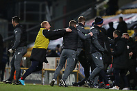 The Wigan bench celebrate a late winner from Michael Jacobs during the Sky Bet League 1 match between Bradford City and Wigan Athletic at the Northern Commercial Stadium, Bradford, England on 14 March 2018. Photo by Thomas Gadd.