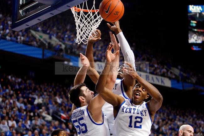 Brandon Knight, Terrence Jones and Josh Harrellson all go up for a rebound in the first half of UK's win over the Penn Quakers at Rupp Arena on Jan. 3, 2011. Photo by Britney McIntosh | Staff