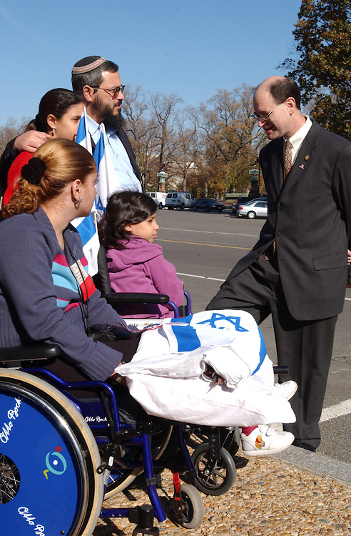 3sherman111301 --  Brad Sherman, D-Calif., greets Michal Genon ,Tehila Cohen, Orit Cohen and their father Ofir Cohen all from Israeli and all injured in terrorist attacks in Israeli. They were here to show solidarity with the American people after the New York and Washington, D.C. terrorist attacks on September 11 2001.
