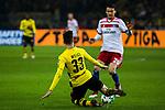 10.02.2018, Signal Iduna Park, Dortmund, GER, 1.FBL, Borussia Dortmund vs Hamburger SV, <br /> <br /> im Bild | picture shows:<br /> Julian Weigl (Borussia Dortmund #33) gegen Albin Ekdal (Hamburger SV #20), <br /> <br /> <br /> Foto &copy; nordphoto / Rauch