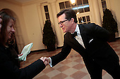 Actor and television host Stephen Colbert, right, greets a member of the French press as he arrives to a state dinner hosted by U.S. President Barack Obama and first lady Michelle Obama in honor of French President Francois Hollande at the White House in Washington, D.C., U.S., on Tuesday, Feb. 11, 2014. Obama and Hollande said the U.S. and France are embarking on a new, elevated level of cooperation as they confront global security threats in Syria and Iran, deal with climate change and expand economic cooperation.<br /> Credit: Andrew Harrer / Pool Via CNP