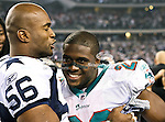 Dallas Cowboys inside linebacker Bradie James (56) and Miami Dolphins running back Reggie Bush (22) in action during the Thanksgiving Day game between the Miami Dolphins and the Dallas Cowboys at the Cowboys Stadium in Arlington, Texas. Dallas defeats Miami 20 to 19...