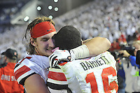25 October 2014:  Ohio State DE Joey Bosa (97) celebrates and hugs QB J.T. Barrett (16) after The Ohio State Buckeyes defeated the Penn State Nittany Lions 31-24 in 2 OTs at Beaver Stadium in State College, PA.