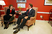 Washington, DC - October 29, 2003 -- California Governor-elect Arnold Schwarzenegger, right, meets  United States Senator Diane Feinstein (Democrat of California), left, in the U.S. Capitol in Washington, DC on October 29, 2003.  He was meeting to discuss ways to bring more money to California to help eliminate its financial crisis..Credit: Paul Hosefros / Pool via CNP