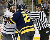 Mike Sislo (UNH - 19), Stephane Da Costa (Merrimack - 24), Bob Bernard - The Merrimack College Warriors defeated the University of New Hampshire Wildcats 4-1 (EN) in their Hockey East Semi-Final on Friday, March 18, 2011, at TD Garden in Boston, Massachusetts.