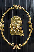 Dublin, Republic of Ireland. Profile of a gentleman in gold on the wall of The Duke public house.