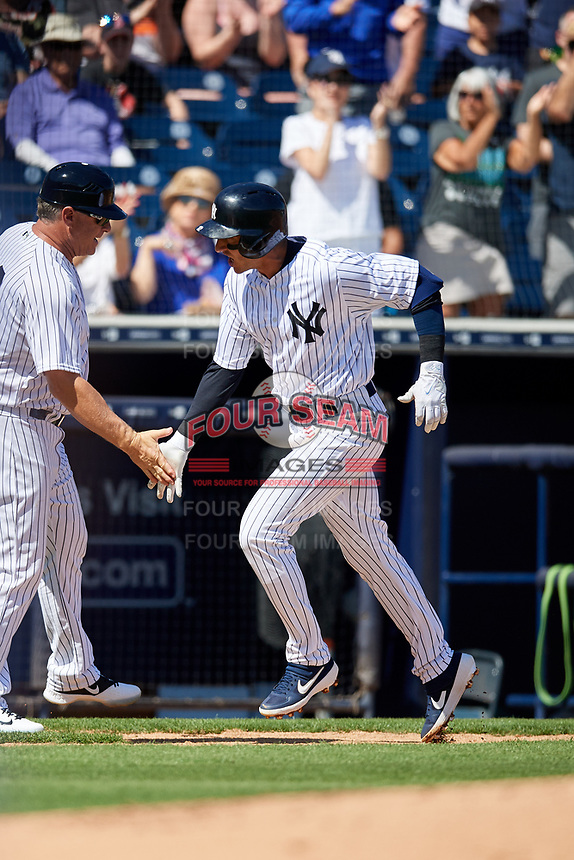 New York Yankees third base coach Phil Nevin congratulates shortstop Troy Tulowitzki (12) as he rounds the bases after hitting a home run during a Grapefruit League Spring Training game against the Toronto Blue Jays on February 25, 2019 at George M. Steinbrenner Field in Tampa, Florida.  Yankees defeated the Blue Jays 3-0.  (Mike Janes/Four Seam Images)