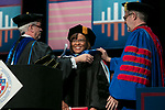 Sharon Draper, distinguished teacher and celebrated novelist, receives her honorary degree Saturday, June 10, 2017, during the DePaul University College of Education commencement ceremony at the Rosemont Theatre in Rosemont, IL. (DePaul University/Jeff Carrion)
