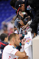 Joel Lindpere (20) of the New York Red Bulls sign autographs. The New York Red Bulls defeated the New England Revolution 2-0 during a Major League Soccer (MLS) match at Red Bull Arena in Harrison, NJ, on October 21, 2010.