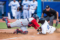 Bralin Jackson (27) of the Hudson Valley Renegades slides across home plate ahead of the tag from Adrian Abreau (2) of the Brooklyn Cyclones as home plate umpire Tyler Olson looks on at Dutchess Stadium on June 18, 2014 in Wappingers Falls, New York.  The Cyclones defeated the Renegades 4-3 in 10 innings.  (Brian Westerholt/Four Seam Images)