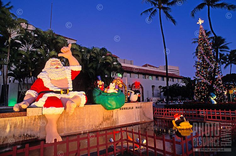 Twilight view of Hawaiian Santa  & Christmas tree at Honolulu Hale