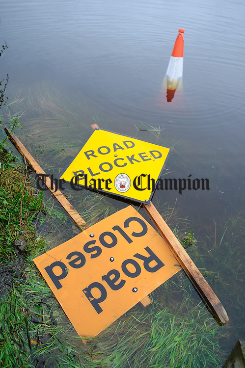 Warning signs float in the flood waters around the Coleman family farm in the Loughinwada area near Peterswell in South Galway. Photograph by John Kelly.