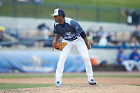 West Michigan Whitecaps relief pitcher Felix Viloria (12) looks to his catcher for the sign against the South Bend Cubs at Fifth Third Ballpark on June 10, 2018 in Comstock Park, Michigan. The Cubs defeated the Whitecaps 5-4.  (Brian Westerholt/Four Seam Images)