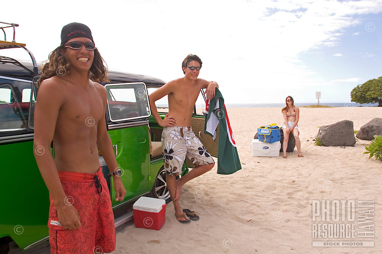 Surfers relaxing at VW camper bus on the beach, Big Island of Hawaii