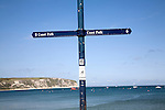 Coast path sign Swanage, Dorset, England. The South West Coast Path National Trail offers 630 miles of superb coastal walking. The walk follows the coast from Minehead on the edge of the Exmoor National Park to the shores of Poole Harbour in Dorset.