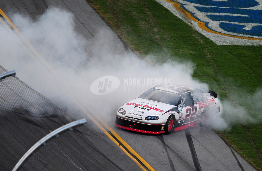 Apr 25, 2010; Talladega, AL, USA; NASCAR Nationwide Series driver Brad Keselowski celebrates after winning the Aarons 312 at the Talladega Superspeedway. Mandatory Credit: Mark J. Rebilas-