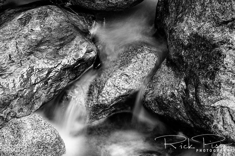 Water flows over granite boulders below Roaring River Falls on the Roaring River in Kings Canyon National Park.