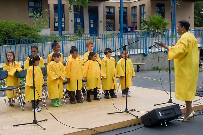 Berkeley CA 1st & 2nd graders in school choir performing at school carnival, led by their director
