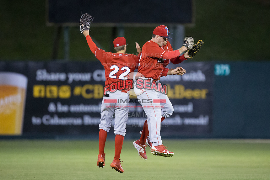 Lakewood BlueClaws outfielders Mickey Moniak (22), Cord Sandberg (32), and Carlos Duran (13) celebrate their win over the Kannapolis Intimidators at Kannapolis Intimidators Stadium on April 7, 2017 in Kannapolis, North Carolina.  The BlueClaws defeated the Intimidators 6-4.  (Brian Westerholt/Four Seam Images)