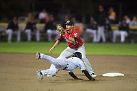 Billings Mustangs shortstop Carlos Rivero (23) covers second base on a steal attempt by Offerman Collado (0) during a Pioneer League game against the Idaho Falls Chukars at Melaleuca Field on August 22, 2018 in Idaho Falls, Idaho. The Idaho Falls Chukars defeated the Billings Mustangs by a score of 5-3. (Zachary Lucy/Four Seam Images)
