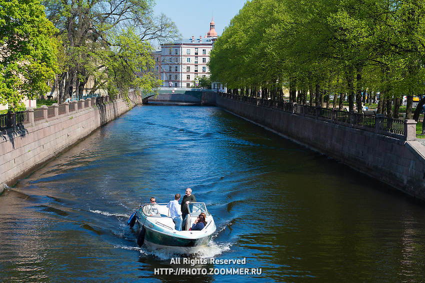 Tourists On A Pleasure Trip In Boat. Griboedov Canal, St Petersburg, Russia