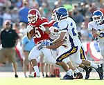 SIOUX FALLS, SD - SEPTEMBER 7:  Caden Quintanilla #25 from Lincoln looks to shake the defense of O'Gorman in the third quarter of their game at the 2013 Presidents Bowl at Howard Wood Field. (Photo by Dave Eggen/Inertia)