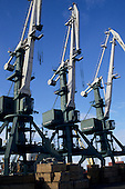 Parnu, Estonia. Cranes in the port of the town, blue sky.