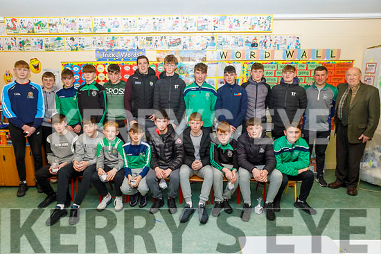 David Moran and Mike Joe Quinlan, guests at the Juvenile GAA medal presentation in Ballyduff on Thursday standing with the U16 team on Thursday.