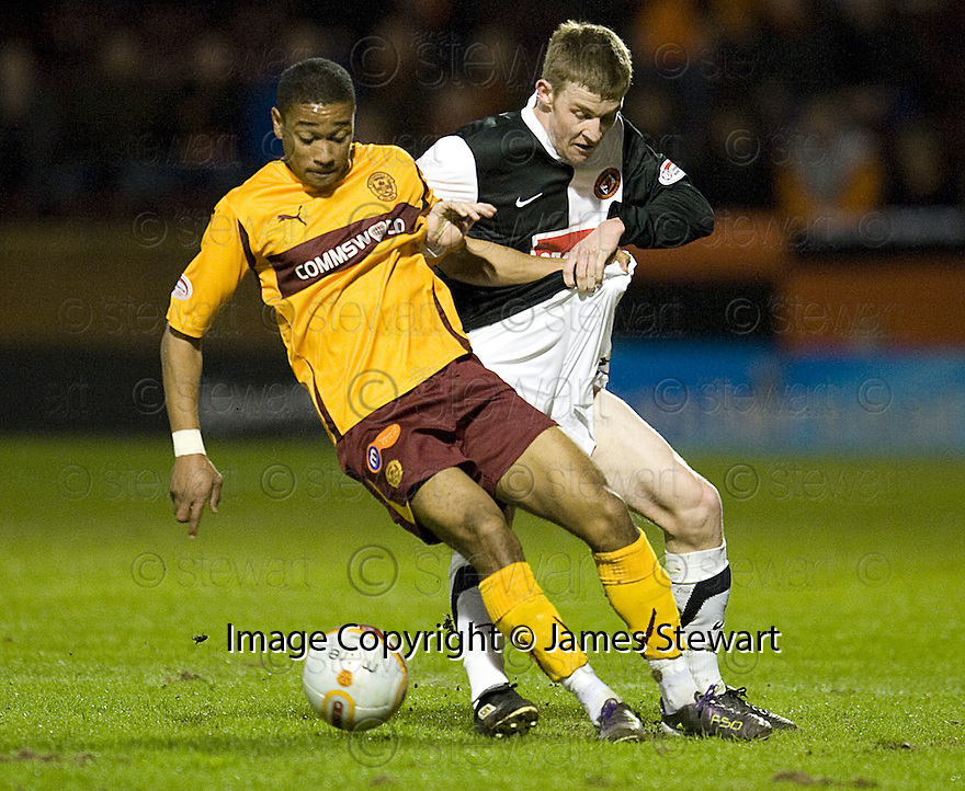 :: MOTHERWELL'S CHRIS HUMPHREY GETS A GRIP OF DUNDEE UTD'S PAUL DIXON  ::.30/03/2011   sct_jsp019_motherwell_v_dundee_utd     .Copyright  Pic : James Stewart.James Stewart Photography 19 Carronlea Drive, Falkirk. FK2 8DN      Vat Reg No. 607 6932 25.Telephone      : +44 (0)1324 570291 .Mobile              : +44 (0)7721 416997.E-mail  :  jim@jspa.co.uk.If you require further information then contact Jim Stewart on any of the numbers above.........