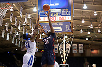 DURHAM, NC - NOVEMBER 29: Eleah Parker #31 of the University of Pennsylvania shoots over Onome Akinbode-James #24 of Duke University during a game between Penn and Duke at Cameron Indoor Stadium on November 29, 2019 in Durham, North Carolina.