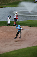 Thongchai Jaidee (THA) finishes the Pro-Am with a shot out of the deep bunker on the 18th at the 2013 ISPS Handa Wales Open from the Celtic Manor Resort, Newport, Wales. Picture:  David Lloyd / www.golffile.ie
