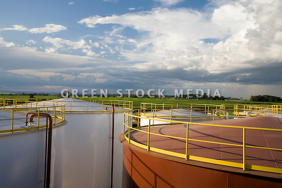 Large white storage tanks holding biodiesel and a brown tank holding animal fat at the Barralcool biofuel production facility in Brazil. Barralcool is surrounded by green fields of sugar cane, a  large amount of which is used at the integrated facility to produce both ethanol and refined sugar. Contact Green Stock Media to view additional images from this photo shoot. Image size: 4368 x 2912 pixels, very high resolution, 12.8 megapixels