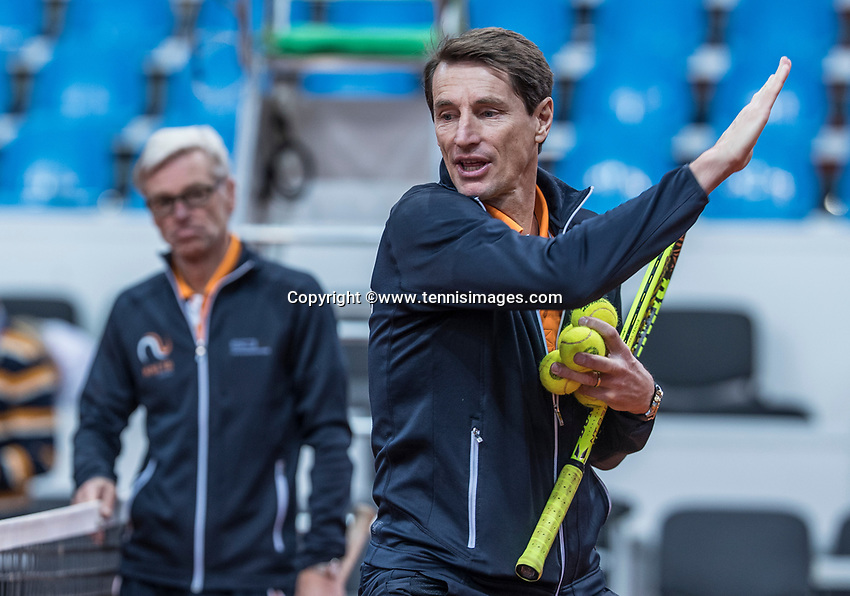 Bratislava, Slovenia, April 23, 2017,  FedCup: Slovakia-Netherlands, Practise Dutch team, captain Paul Haarhuis shows the way, in the background coach Martin Bohm<br /> Photo: Tennisimages/Henk Koster