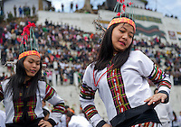 Chapchar Kut is the harvest festival celebrated in Mizoram, a state of North East India. At this festival, the Cheraw or bamboo dance is performed by young boys and girls. The boys across the performance ground clap bamboos in a synchronised beat, while the girls step within the bamboo patterns created by the boys. The footwork steps change from time to time along with the beat and the girls have to be careful not to get hurt. Image taken at Aizawl, Mizoram.