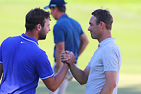 Scott Jamieson and Florian Fritsch shake hands at the end of their round at the 18th  during the BMW PGA Golf Championship at Wentworth Golf Course, Wentworth Drive, Virginia Water, England on 26 May 2017. Photo by Steve McCarthy/PRiME Media Images.