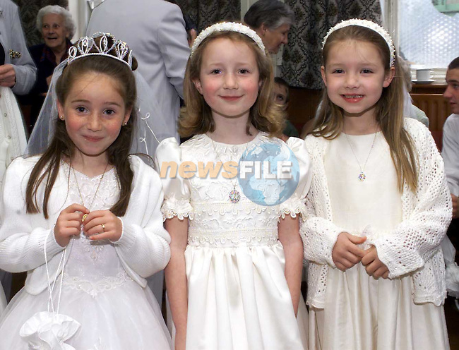 Jessica McDonald Forest View, Emma Foley 5 Oaks and Ciara Baily Meadow View after first communion in St Marys Church.Picture Fran Caffrey Newsfile