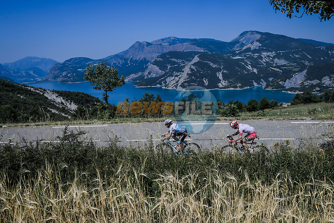 Alexey Lutsenko (KAZ) Astana Pro Team and Pierre Luc Perichon (FRA) Cofidis pass the Lac de Serre-Ponçon during Stage 18 of the 2019 Tour de France running 208km from Embrun to Valloire, France. 25th July 2019.<br /> Picture: ASO/Pauline Ballet | Cyclefile<br /> All photos usage must carry mandatory copyright credit (© Cyclefile | ASO/Pauline Ballet)