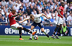Harry Kane of Tottenham Hotspur is challenged by Jesse Lingard of Manchester United during the FA cup semi-final match at Wembley Stadium, London. Picture date 21st April, 2018. Picture credit should read: Robin Parker/Sportimage