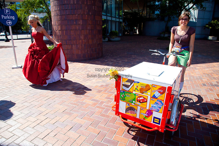 An ice cream vendor sells her wares by bicycle at Tom McCall waterfront park in downtown Portland, Oregon