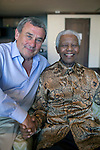 CAPE TOWN, SOUTH AFRICA – APRIL 2: Former President Nelson Mandela of South Africa is greeted by Sol Kerzner on April 2, 2009 at the One&Only hotel in Cape Town, South Africa. Mr. Kerzner, a hotel magnate, invited Mr. Mandela to the opening of his latest hotel located at the W&A Waterfront in the city. (Photo by Per-Anders Pettersson)