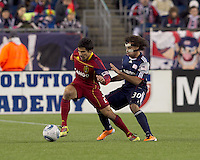 Real Salt Lake defender Tony Beltran (2) dribbels as New England Revolution defender Kevin Alston (30) defends. In a Major League Soccer (MLS) match, Real Salt Lake defeated the New England Revolution, 2-0, at Gillette Stadium on April 9, 2011.