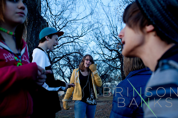 Kendrick Brinson.LUCEO..Randie Shipp (left to right), 13, Trevor White, 14, Ashley Thorton, 13, Ben Putman, 14, and Robbie Reynolds, 14, gather to talk at the Williston Skatepark in Williston, North Dakota, January 2012. Williston is currently experiencing an influx of people relocating there for the town's third oil boom. ..Model Released: no.Assigning Editor: Michael Wichita.