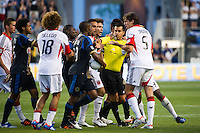 Referee Ricardo Salazar separates players during a scuffle. DC United defeated Philadelphia Union 1-0 during a Major League Soccer (MLS) match at PPL Park in Chester, PA, on June 16, 2012.